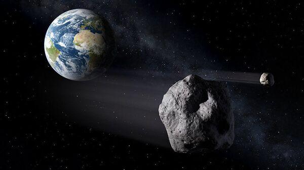 Астероид в космосе на фоне земли. Иллюстративное фото - Sputnik Узбекистан