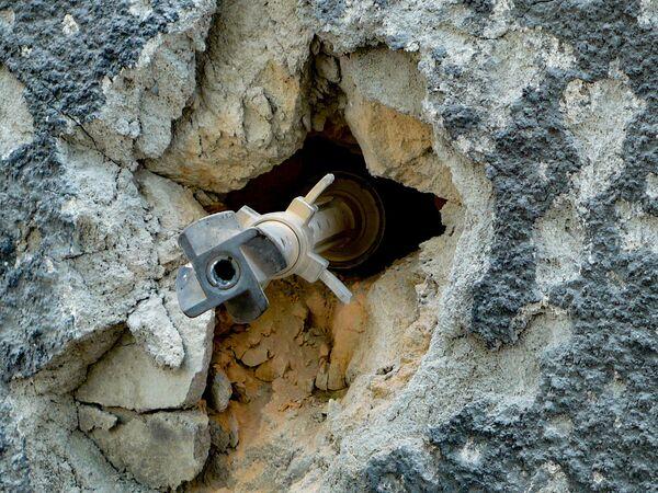 Неразорвавшийся снаряд в стене. - Sputnik Узбекистан
