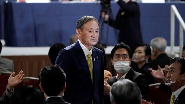 Генеральный секретарь японского правительства Ёсихидэ Суга, избранный лидером правящей в Японии партии - Sputnik Ўзбекистон