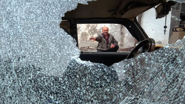 Avtomobil, povrejdennыy v rezultate obstrela v Stepenakerte - Sputnik Oʻzbekiston