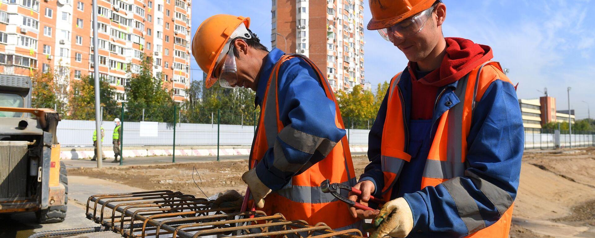 Рабочие на строительной площадке - Sputnik Ўзбекистон, 1920, 13.09.2021