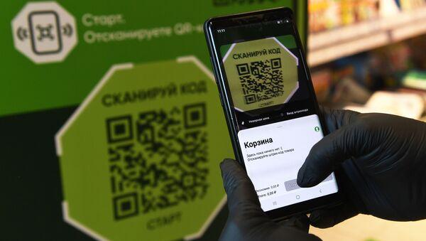 Покупка с использованием смартфона с помощью бесконтактной системы - Sputnik Узбекистан