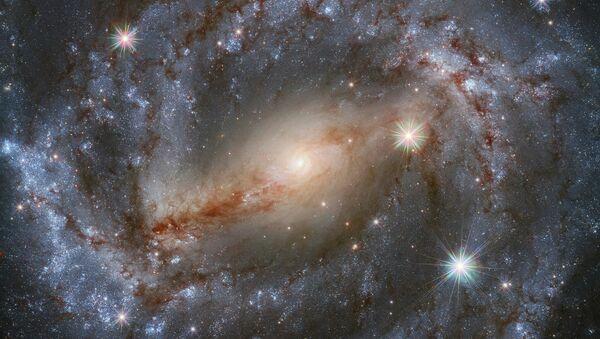 Spiralnaya galaktika NGC 5643 s peremыchkoy (SBc) v sozvezdii Volka - Sputnik Oʻzbekiston