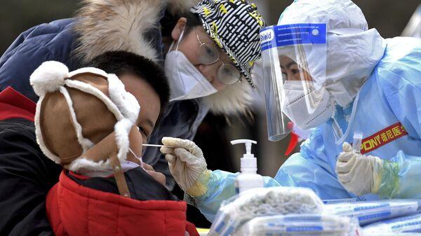 Testirovaniye na koronavirus v Kitaye - Sputnik Oʻzbekiston
