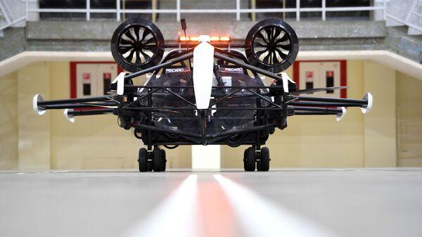 Испытание дрона-такси в помещении Малой спортивной арены олимпийского комплекса Лужники в Москве - Sputnik Ўзбекистон