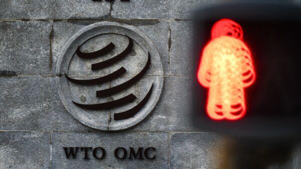 Emblema Vsemirnoy torgovoy organizatsii (VTO) vozle zdaniya shtab-kvartirы organizatsii v Jeneve - Sputnik Oʻzbekiston