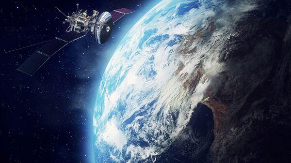 Спутник в космосе у Земли  - Sputnik Узбекистан