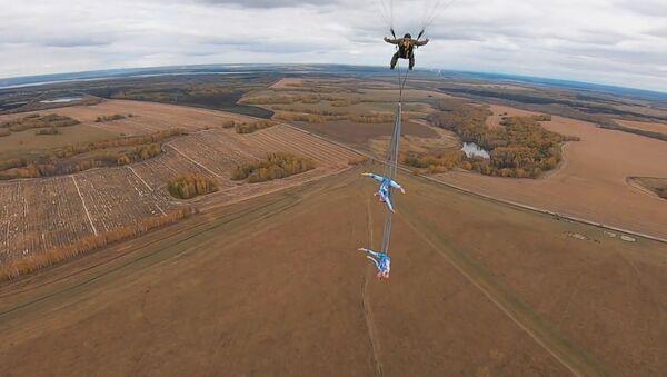 Сумасшедшие трюки без страховки на высоте 600 метров - видео - Sputnik Узбекистан