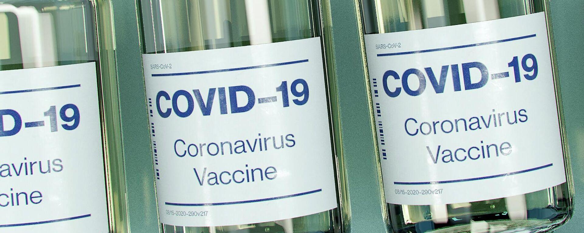 Бутылочки с вакциной от коронавируса. Иллюстративное фото - Sputnik Узбекистан, 1920, 31.03.2021