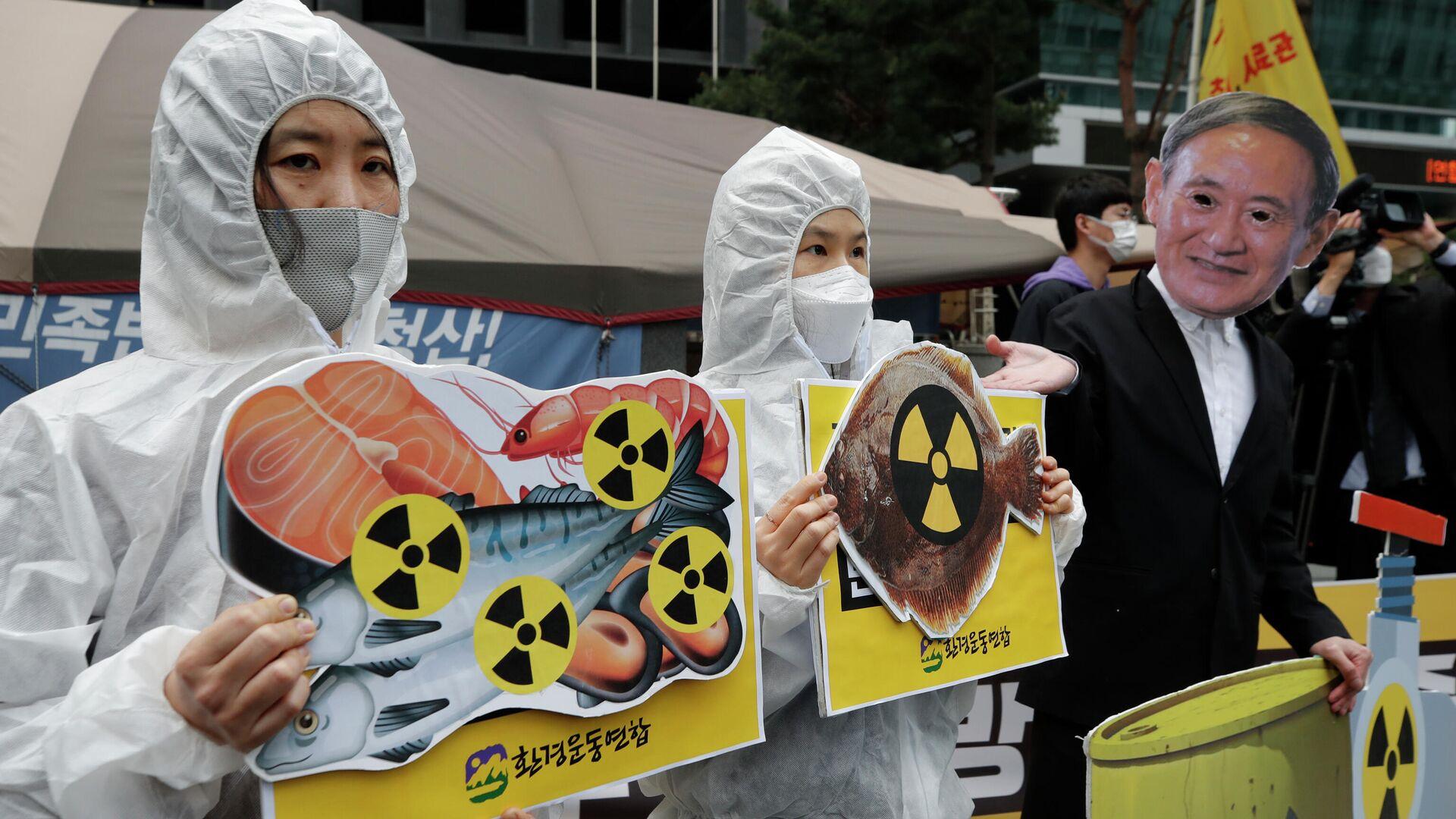 Протест против сброса воды с АЭС Фукусима-1 в океан в Сеуле, Южная Корея - Sputnik Узбекистан, 1920, 14.04.2021