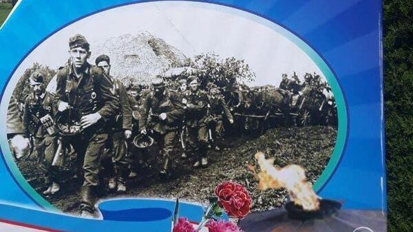 Скандал в Фергане: на плакате в честь Победы появились немецкие солдаты - Sputnik Узбекистан