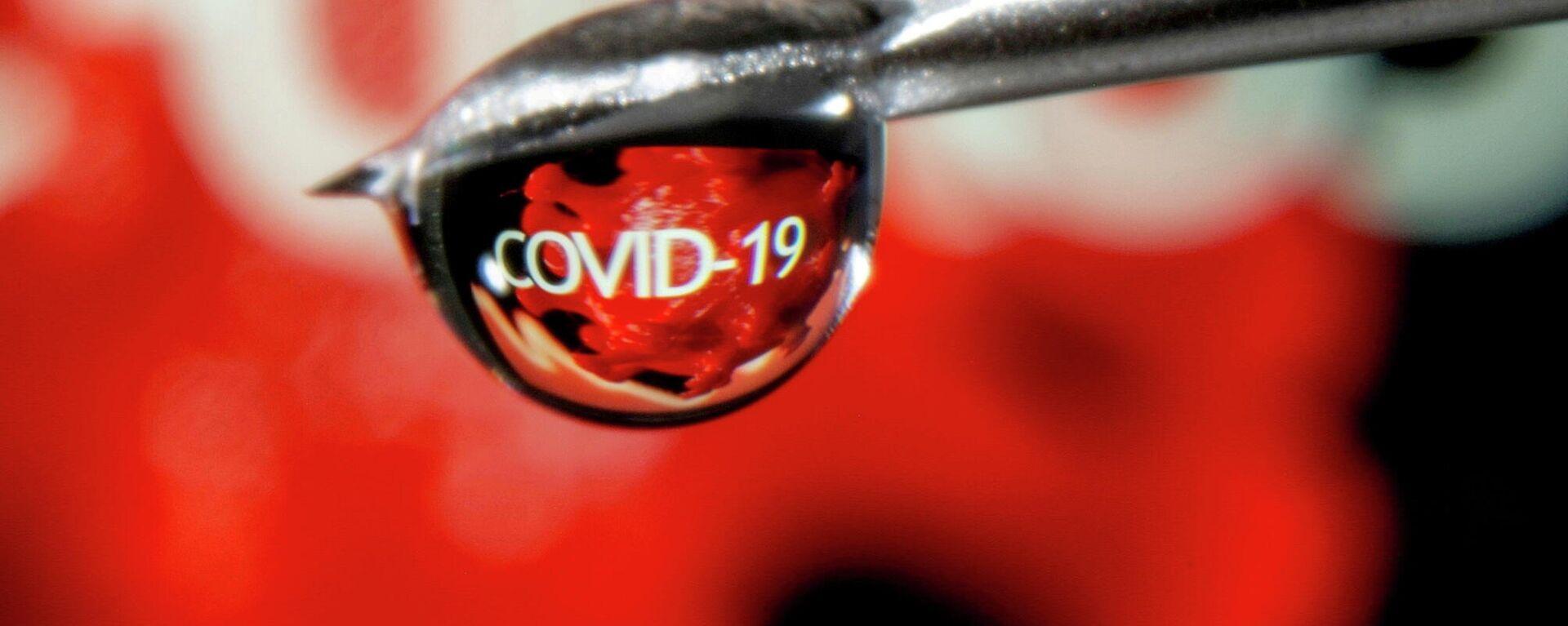 Слово COVID-19 в капле на игле шприца - Sputnik Узбекистан, 1920, 02.07.2021