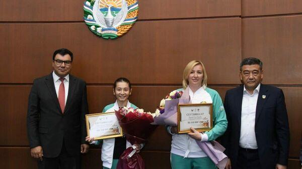 Пробившихся на Олимпиаду-2020 спортсменов наградили премиями - Sputnik Узбекистан