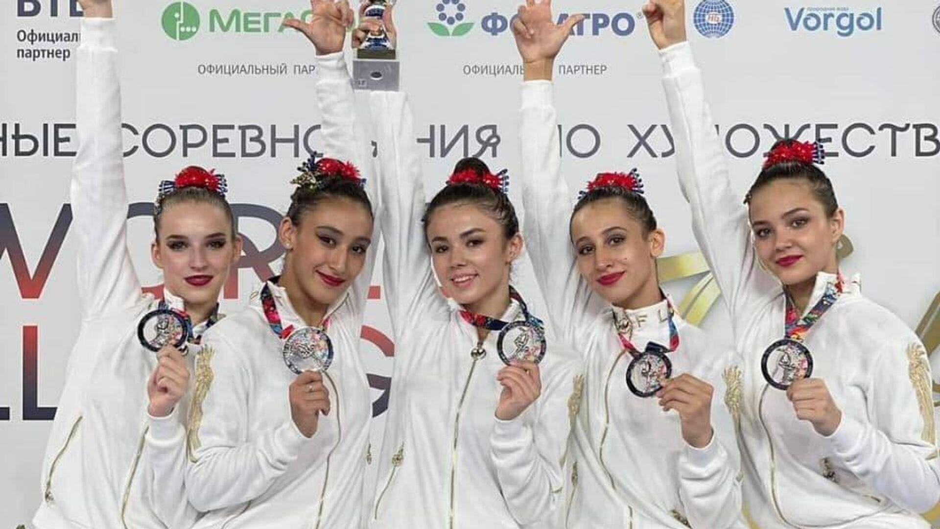 Сборная Узбекистана по художественной гимнастике - Sputnik Узбекистан, 1920, 13.07.2021