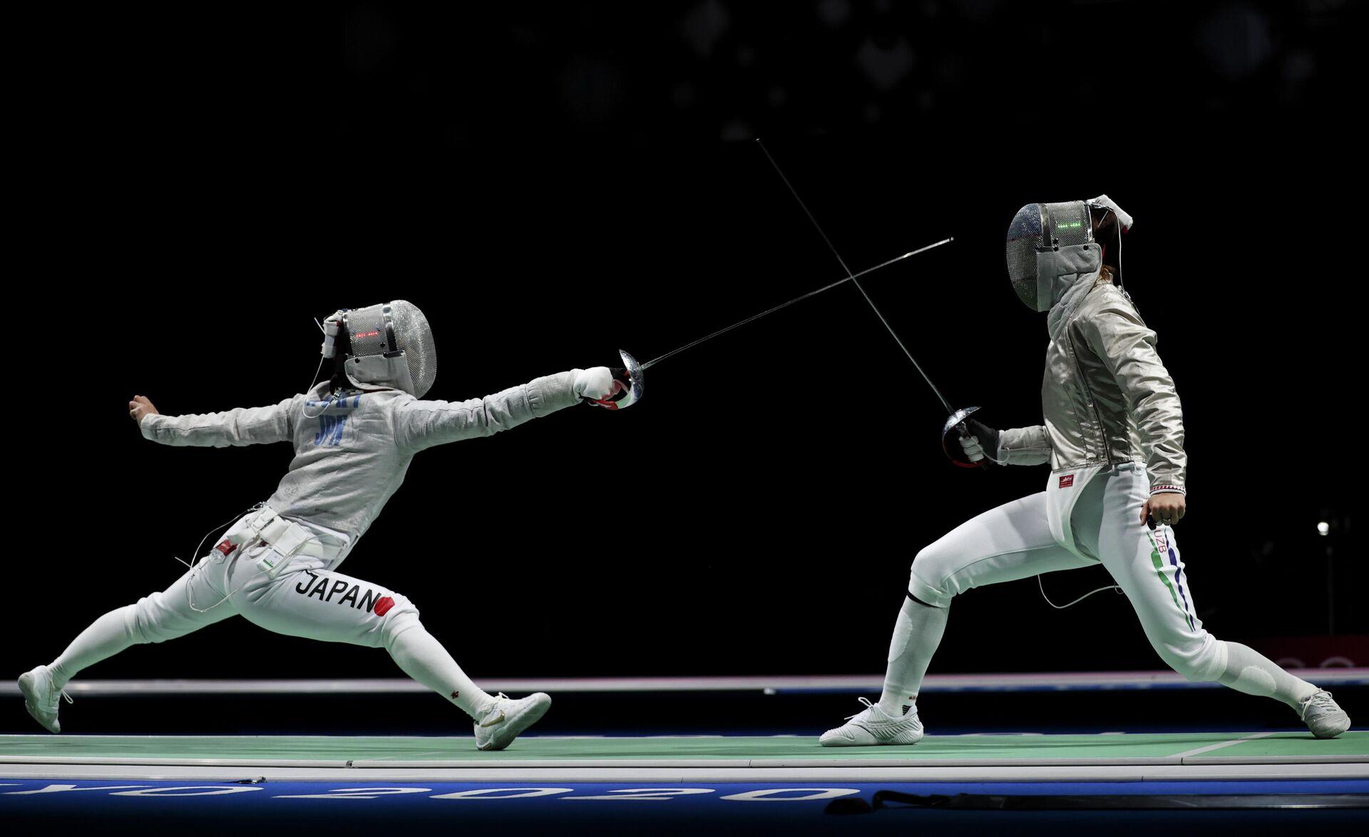 Чика Аоки из Японии в бою против Зайнаб Дайибековой из Узбекистана на олимпийских играх в Токио  - Sputnik Ўзбекистон, 1920, 26.07.2021