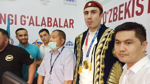 Встреча олимпийской сборной Узбекистана в аэропорту Ташкента - Sputnik Узбекистан