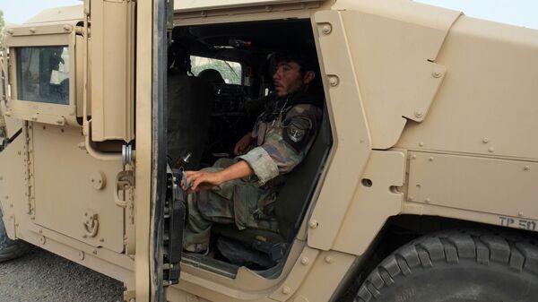Афганские силы обороны и безопасности на линии соприкосновения с талибами в 7-ом районе города Кандагар - Sputnik Узбекистан