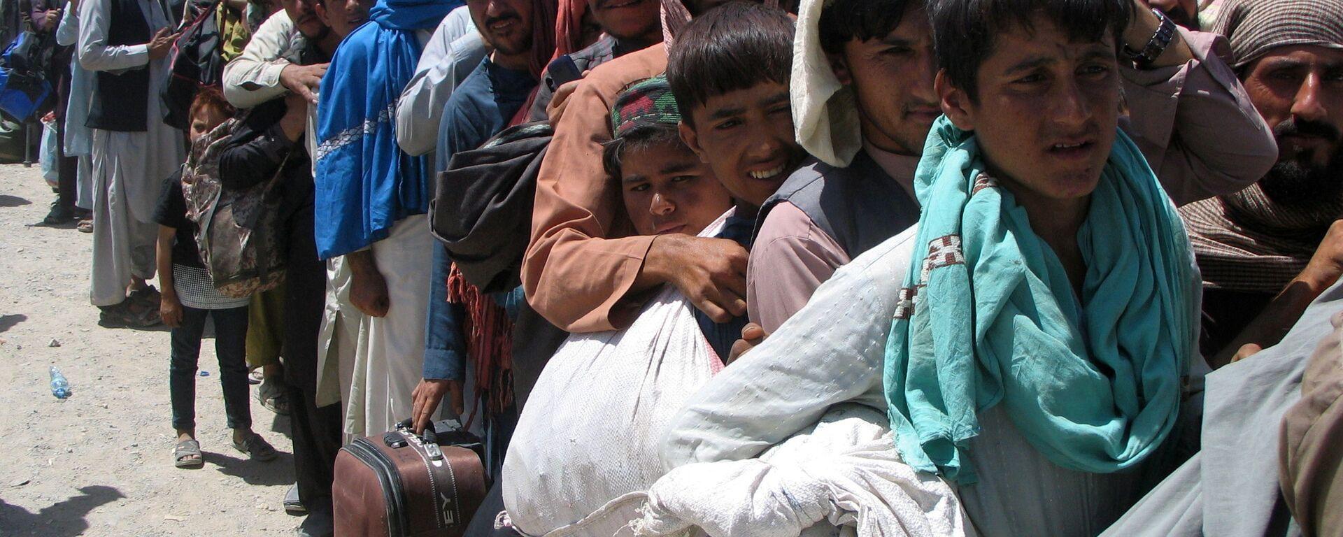 На пропускном пункте «Ворота дружбы» в пакистано-афганском пограничном городе Чаман - Sputnik Узбекистан, 1920, 19.08.2021