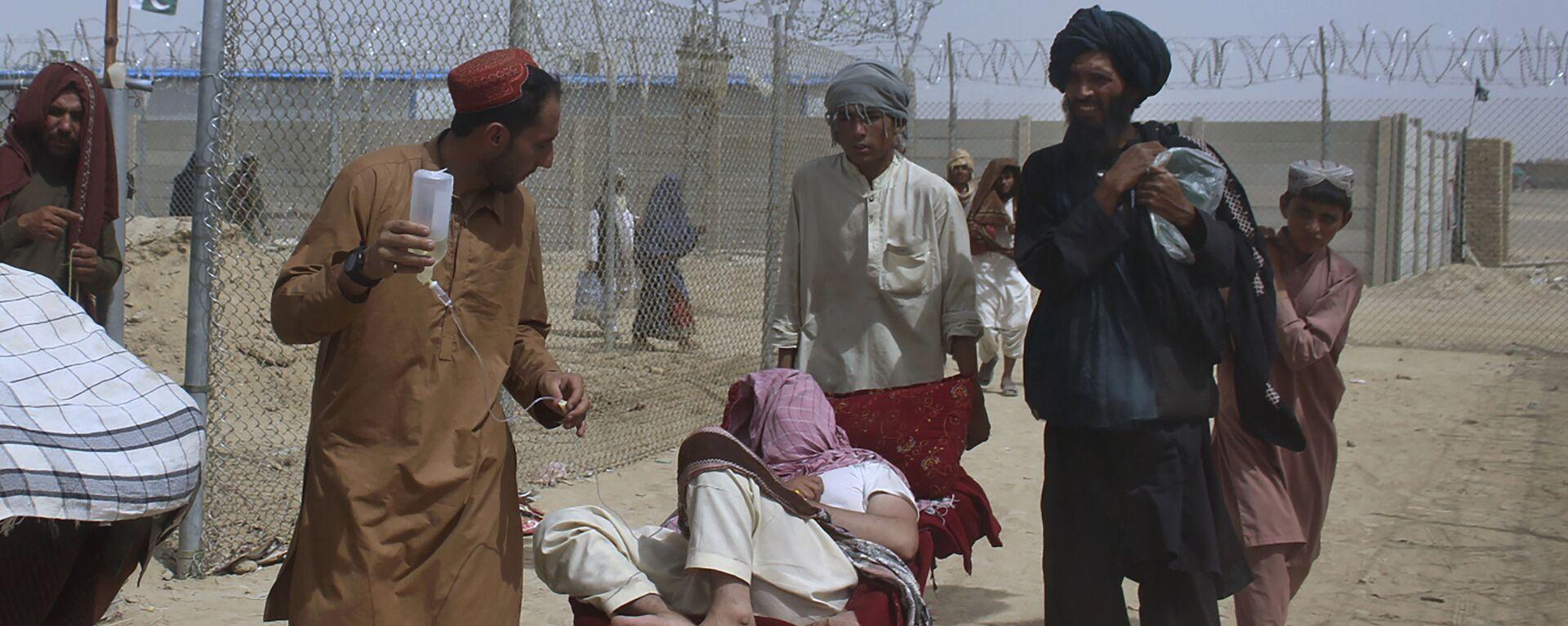 Афганские беженцы въезжают в Пакистан через пограничный переход в Чамане - Sputnik Ўзбекистон, 1920, 26.08.2021