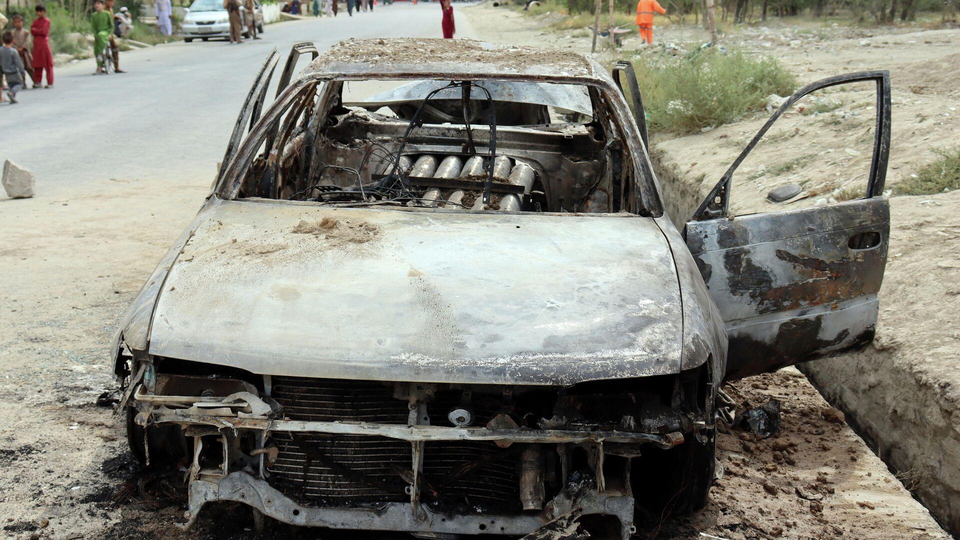 Взорванный автомобиль в Кабуле - Sputnik Узбекистан, 1920, 31.08.2021