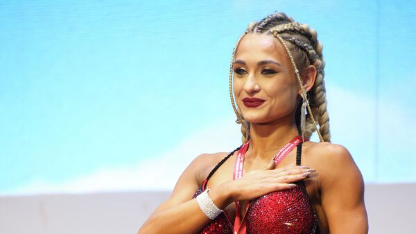 Эвелина Юсупова заняла первое место на XII чемпионате мира по бодибилдингу в Ташкенте - Sputnik Узбекистан