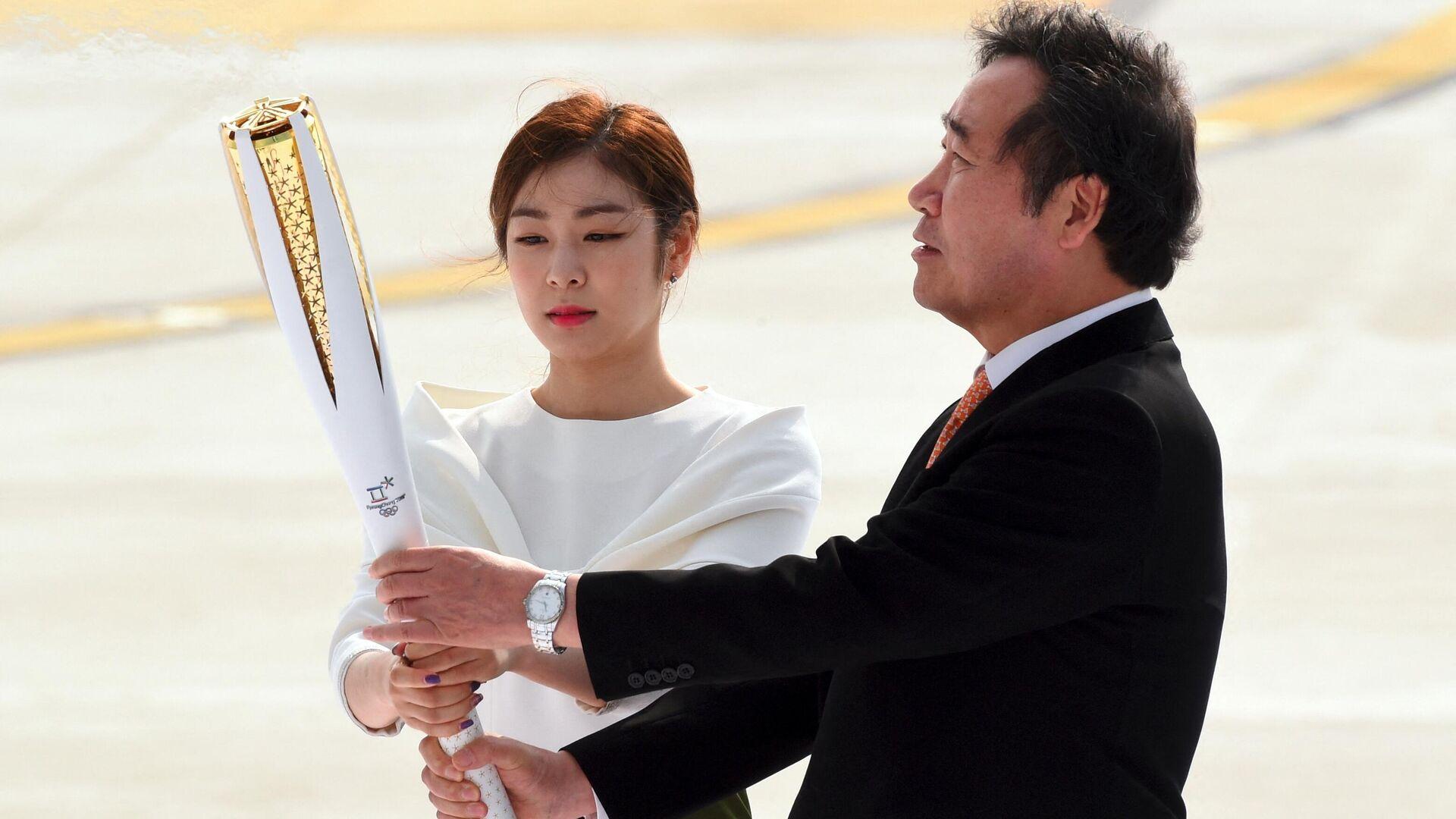 Торжественная церемония прибытия олимпийского огня в Токио - Sputnik Узбекистан, 1920, 09.07.2021