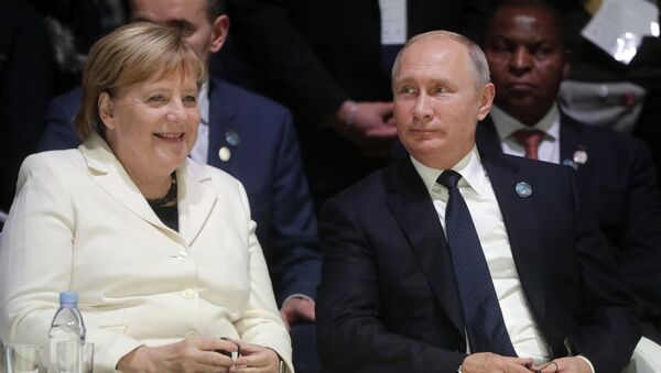Владимир Путин и Ангела Меркель - Sputnik Узбекистан