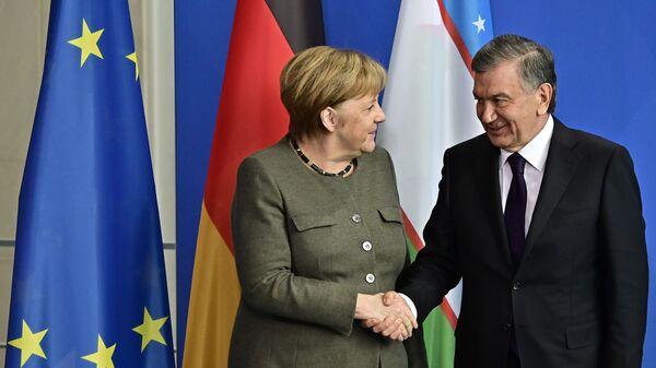 Shavkat Mirziyoyev i Angela Merkel - Sputnik Oʻzbekiston