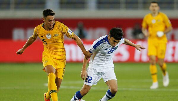 Матч между сборной Узбекистана и Австралии по футболу на Кубке Азии 2019 - Sputnik Узбекистан