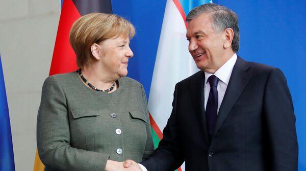 Президент Узбекистана Шавкат Мирзиёев и Канцлер ФРГ Ангела Меркель - Sputnik Ўзбекистон