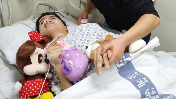Узбекистанец Абрам Окилов в корейской больнице Сангги Пик Пионвон - Sputnik Ўзбекистон
