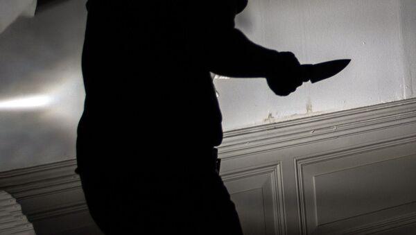 Силуэт человека с ножом в руке - Sputnik Ўзбекистон
