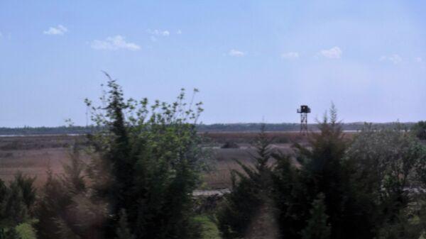 Город расположен на правом берегу реки Амударья, по которой проходит граница Республики Узбекистан с Исламской Республикой Афганистан. - Sputnik Ўзбекистон