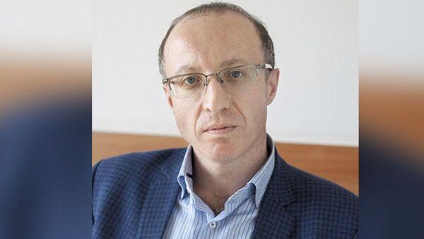 Руководитель департамента разработки беспилотных транспортных средств Cognitive Technologies Юрий Минкин - Sputnik Узбекистан