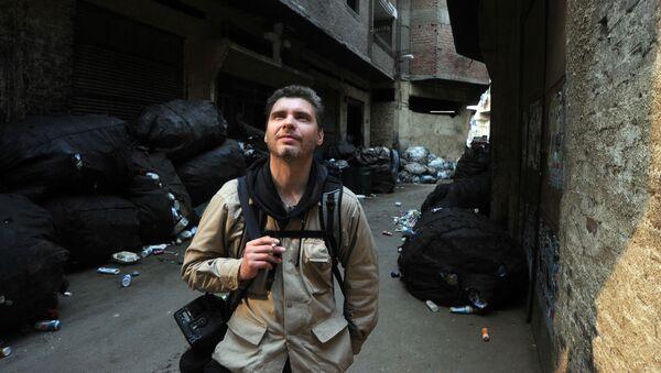 Фотокорреспондент Андрей Стенин на улице Каира - Sputnik Узбекистан