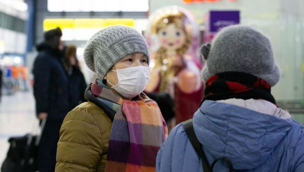 Пассажиры в зоне международных прилетов аэропорта Владивостока - Sputnik Узбекистан