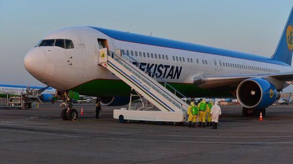 В Ташкент прилетел самолет с пассажирами из г. Ухань - Sputnik Ўзбекистон