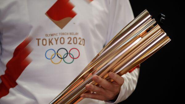 Факел Олимпийских игр 2020 года, которые пройдут в Токио - Sputnik Ўзбекистон