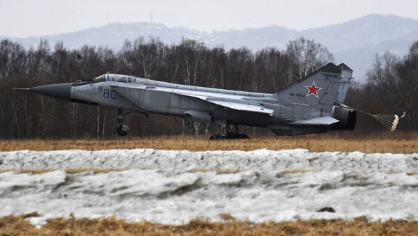 Учебно-тренировочные полеты Су-35С и Миг-31 в Приморье - Sputnik Ўзбекистон