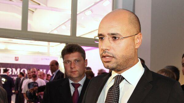 Старший сын бывшего ливийского лидера Сейф Аль Ислам Каддафи - Sputnik Узбекистан