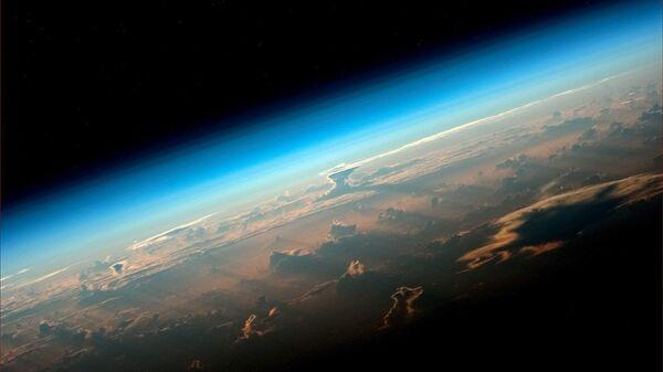 Вид на Землю с борта МКС снятый космонавтом Роскосмоса Олегом Артемьевым - Sputnik Узбекистан