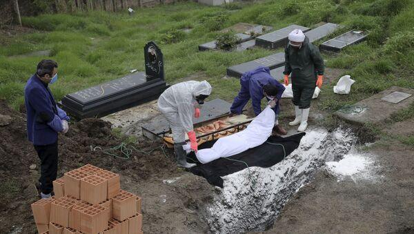 Похороны человека, скончавшегося от COVID-19 - Sputnik Ўзбекистон