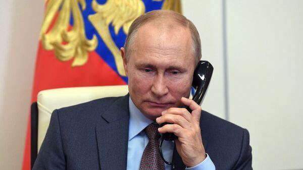 Президент РФ В. Путин провел встречу с премьер-министром РФ М. Мишустиным - Sputnik Ўзбекистон