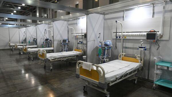 Палаты во временном госпитале для пациентов с COVID-19  - Sputnik Ўзбекистон