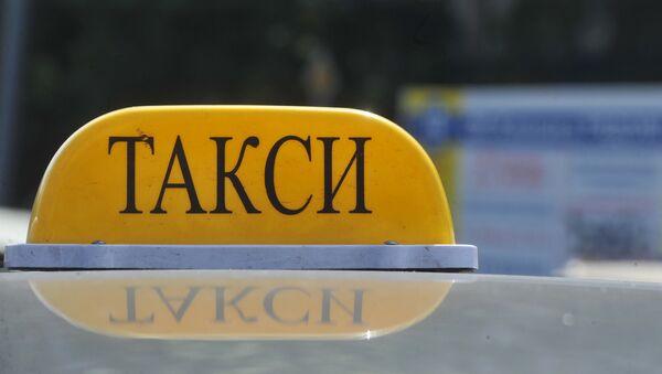 Znak taksi - Sputnik Oʻzbekiston