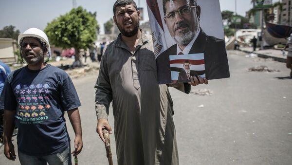 Misrning taxtdan agʻdarilgan prezidenti Muhammad Mursiy tarafdorlari - Sputnik Oʻzbekiston