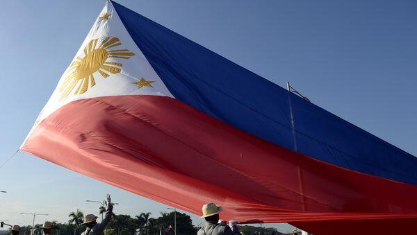 Филиппин байроғи - Sputnik Ўзбекистон