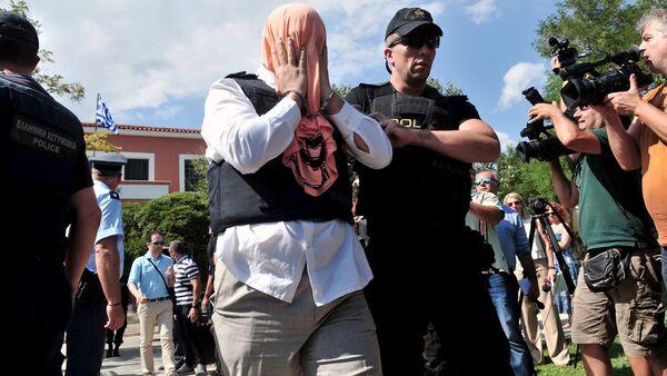 Греция полициячи туркиялик зобит билан бирга - Sputnik Ўзбекистон