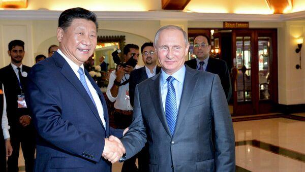 Путин Ва Си Цзиньпиннинг БРИКС саммитида учрашуви - Sputnik Ўзбекистон