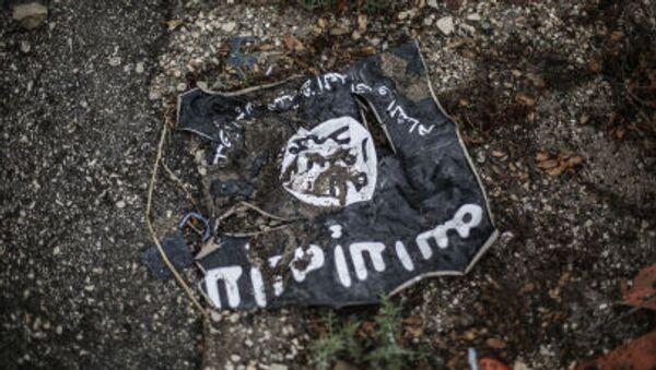 Флаг радикальной исламистской организации Исламское государство Ирака и Леванта - Sputnik Ўзбекистон